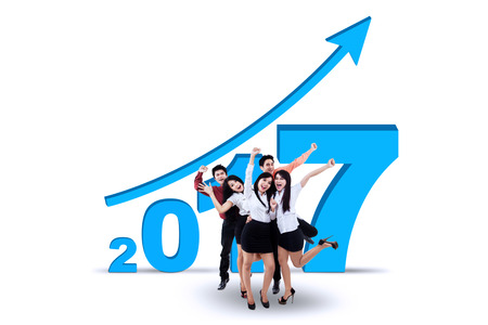 year increase: Successful business team with blue upward arrow and number 2017, isolated on white background Stock Photo