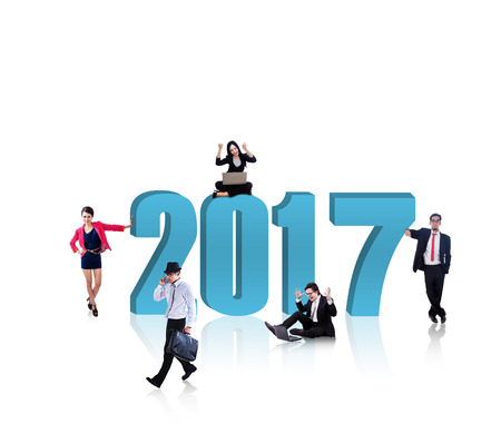 onwards: Image of busy business people with blue number 2017, isolated on white background. Shot in the studio