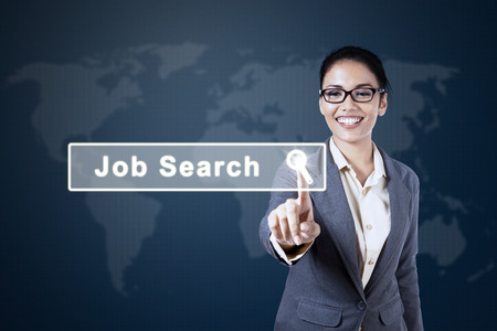 joblessness: Concept of Job Search with a young Asian businesswoman touching a job search button on the virtual screen Stock Photo