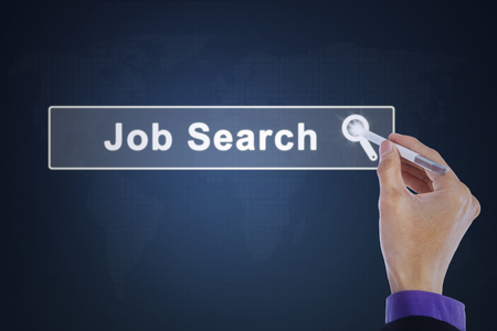 stylus pen: Businessman hand touching a job search button with a stylus pen on the virtual screen. Concept of job search.