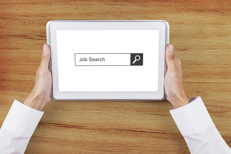 hand job: Businessman hand holding a digital tablet with job search bar on the screen. Concept of Job Search