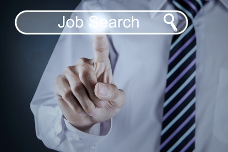 hand job: Concept of Job Search with businessman hand pressing a virtual job search button on the futuristic interface