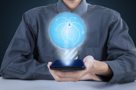 businessman phone: Close up of businessman holding modern smartphone while showing 3d earth globe with connection network Stock Photo