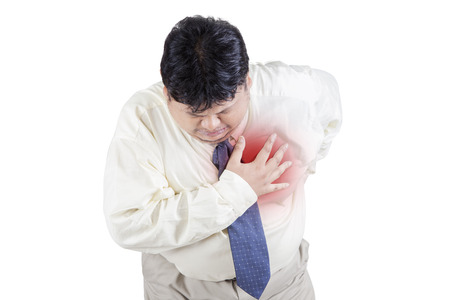 Image of businessman having heart attack, isolated on the white background Stock Photo
