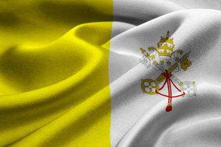 Close up of fabric flag of Vatican City waving in the wind