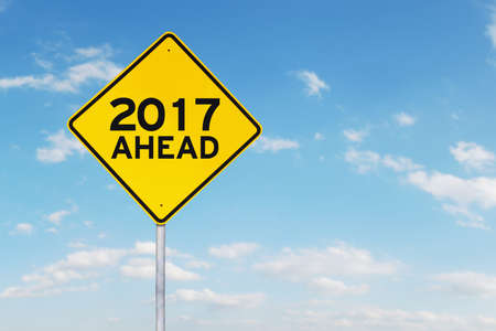 financial year: Yellow 2017 and ahead road sign or street sign isolated on sky background
