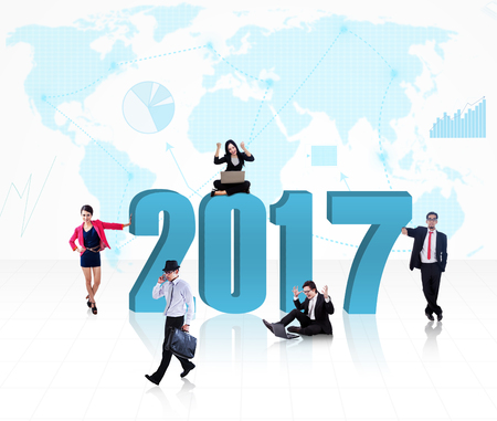 turn of the year: Business people in different situations with a big 2017 and a business graph arrow going up and showing the map of the world in the background. Stock Photo
