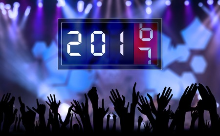 count down: Silhouette of crowd hands people celebrate new year and count down time with number 2017