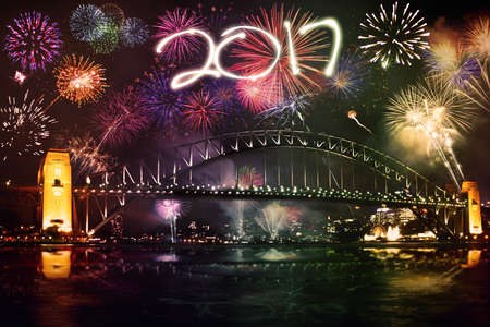 colourful sky: Image of colourful fireworks on the sky night while celebrating new year in the bridge Sydney
