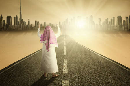 worshipper: Image of muslim man prays on the road while wearing muslim clothes