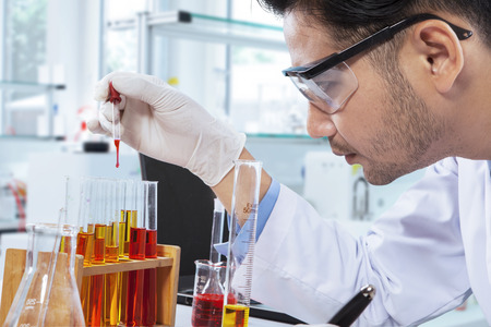 research science: Smart chemist doing the research by using chemical liquid in the laboratory