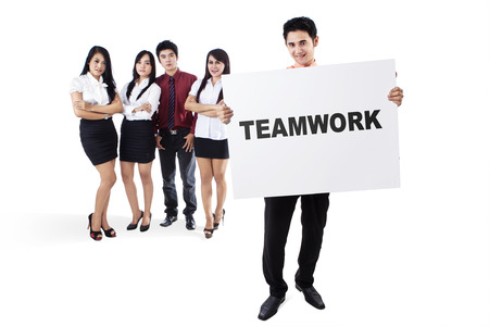 proclaim: Portrait of business team holding and showing word of teamwork on the whiteboard, isolated on the white background Stock Photo