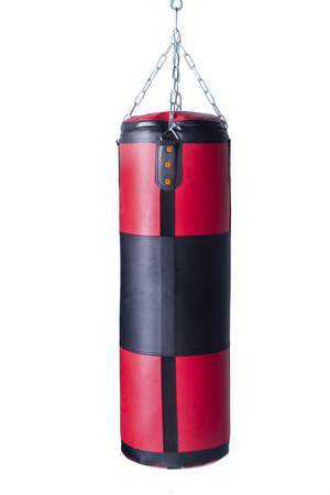 punching: Red black punching bag for boxing training, isolated on white background Stock Photo
