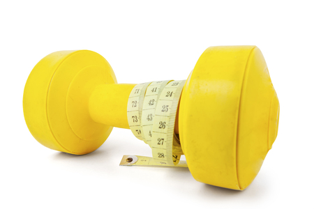 Close up of  yellow barbell wrapped measuring tape, isolated on white background