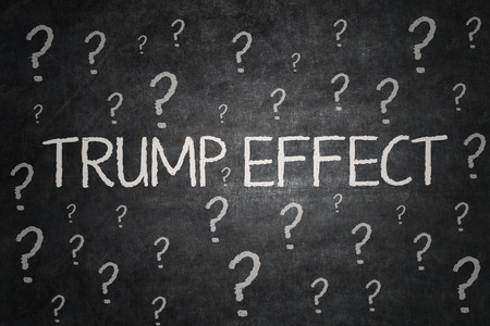 Image of question marks and Trump Effect word on the blackboard. Symbolizing uncertainty of Trump Effect as a president Stock Photo