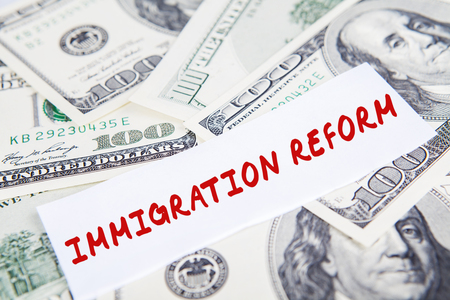 paper currency: Image of Immigration Reform word on the paper with dollars currency
