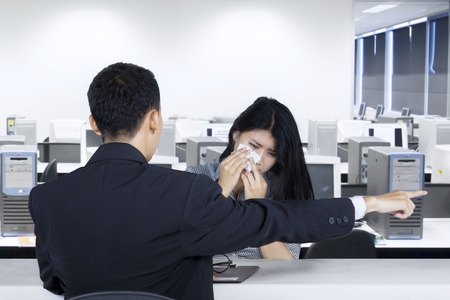 Portrait of a female worker looks crying after fired by her leader in the office