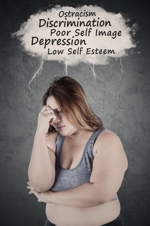 low self esteem: Overweight woman thinking her problems and looks stressful while wearing sportswear