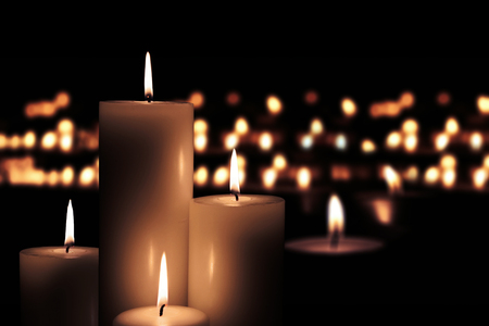 Picture of Easter candles burning at night with golden light of candle flame Stock Photo