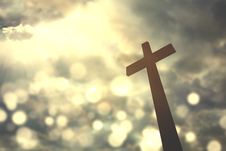 sunlight sky: Silhouette of christian cross symbol with bright sunlight on the sky Stock Photo
