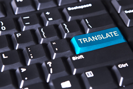 Image of computer keyboard with text of translate on the blue button Stock Photo