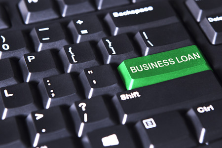 computer button: Image of computer keyboard with text of business loan on the green button