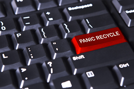recycles: Image of red button with text of panic recycles on the computer keyboard