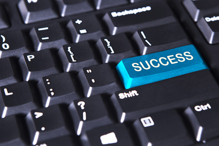 computer button: Image of blue button with success word on the computer keyboard