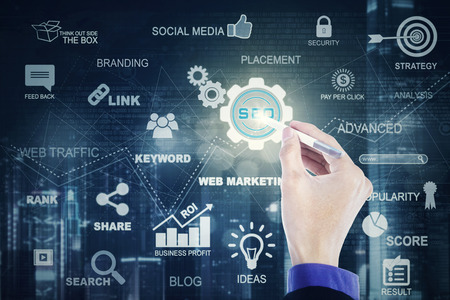 hand press: Businessman hand using a stylus pen to press a virtual SEO icon on the digital screen. SEO concept Stock Photo