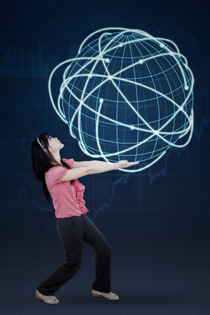 internet globe: Young businesswoman carrying a globe with internet connection network symbol