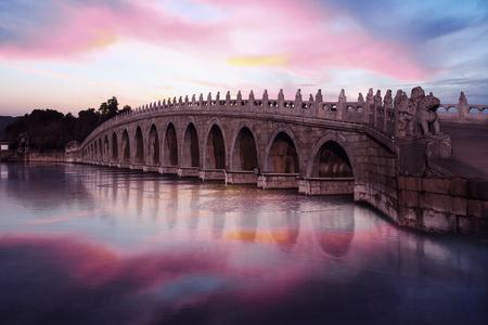 Image of beautiful twilight sky and stone bridge at the Summer Palace, Beijing