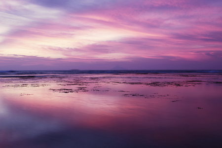 sky reflection: Beautiful beach view at sunset time with purple sky and reflection on the water Stock Photo