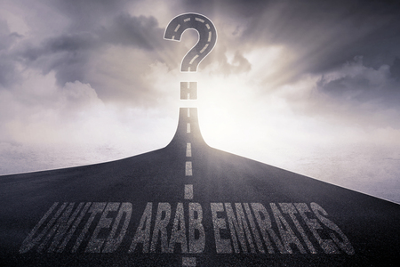 United Arab Emirates word written on the asphalt way with question mark at the end of a road