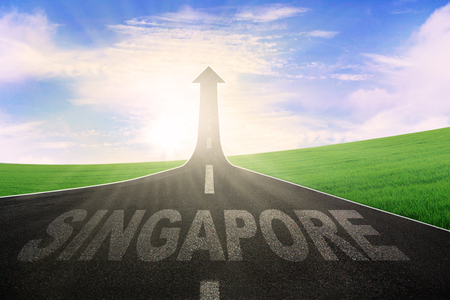 Picture of highway leading to an arrow upward and symbolizing success with a word of Singapore on the street