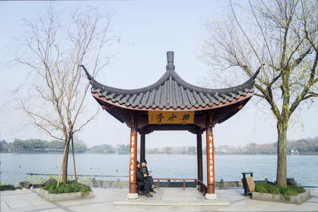 HANGZHOU, CHINA. April 13, 2017: Chinese ancient pavilion or shelter on the West Lake in Hangzhou, China