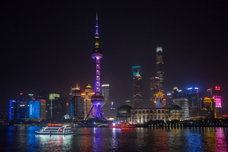 popular: SHANGHAI, China. April 18, 2017: Beautiful view of Oriental Pearl TV Tower with colorful lights in Shanghai, China. Shot from Huangpu river