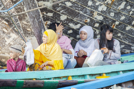 JAKARTA, Indonesia. April 18, 2017: Muslim people ready to praying in the mosque while sitting in the boat