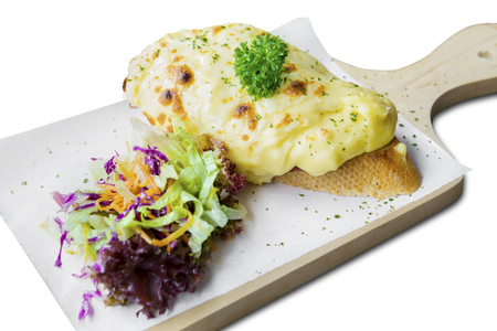 close up: Delicious cheese bread with salad on bake paper, isolated on white background
