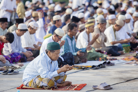 JAKARTA, Indonesia. April 18, 2017: Asian Muslim people praying to Allah while celebrating Eid Mubarak, which marks the end of the month of Ramadan
