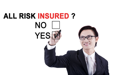 Asian male worker using a marker while approving about a question of all risk insured on the whiteboard photo