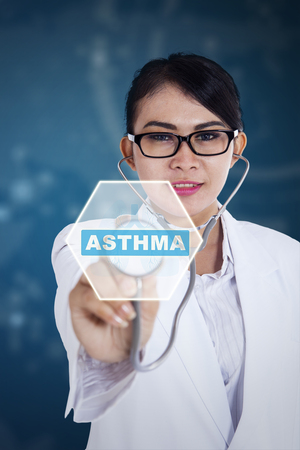Image of female doctor using a stethoscope while touching asthma word on the virtual screen Stock Photo