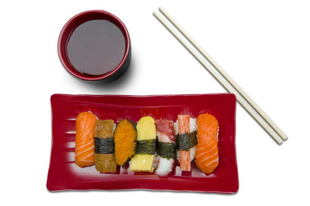 white yummy: Variety of yummy sushi on the plate with chopsticks and soy sauce, isolated on white background
