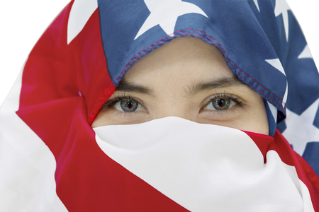 contemporary: Image of young woman wearing veil made out from an American flag on the studio