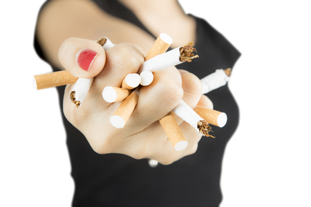 Woman destroying cigarettes in her hand, concept of refuse bad habit, isolated on white background Stock Photo