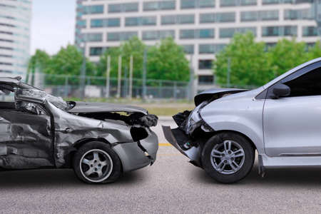 total loss: Image of two cars in collision on the road. Concept of car accident