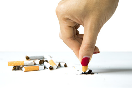Woman destroying a cigarette in her hand, concept of refuse bad habit, isolated on white background Stock Photo