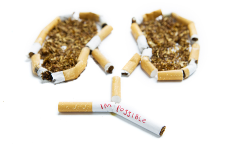 Concept of Quit smoking. Image of impossible word on the cigarette with tobacco shaped a human lungs
