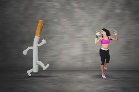 Portrait of Indian woman looks scared while running away by a cigarette Stock Photo