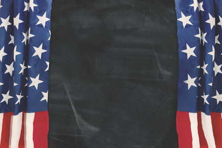 Fabric curtains of an American flag showing empty copy space on the blackboard Stock Photo