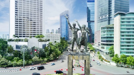 aerial view of welcome statue in the downtown Jakarta with cloudy sky